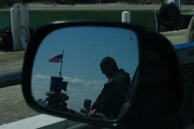 Ferry man preparing for docking.
