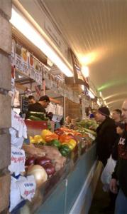 Fruit and veggie vendors at the West Side Market.