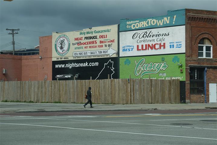 A hipster strolls through a 'thriving' block of Detroit.