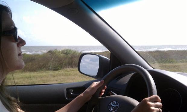 Lisa driving along the Gulf Coast of Louisiana.