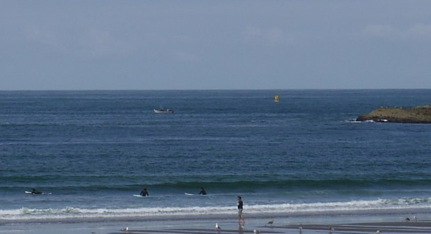 Zooming in on a dory off Pacific City, Oregon.