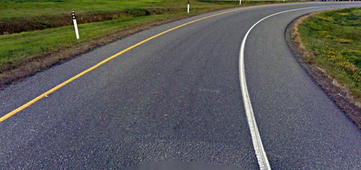 pavement markings showing you are driving in the right direction