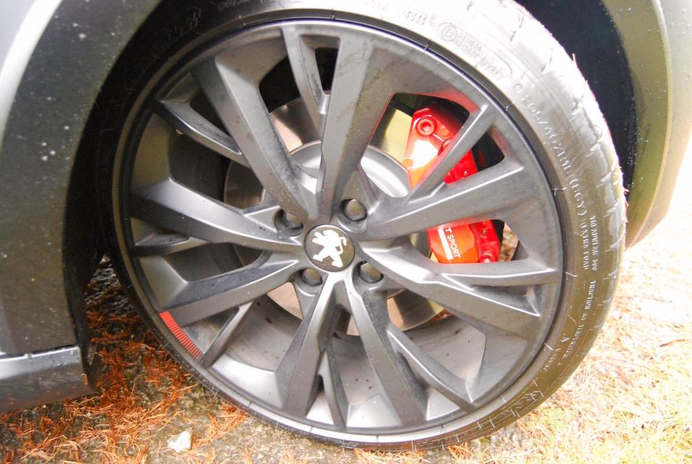 208 gti by peugeot sport front wheel brakes
