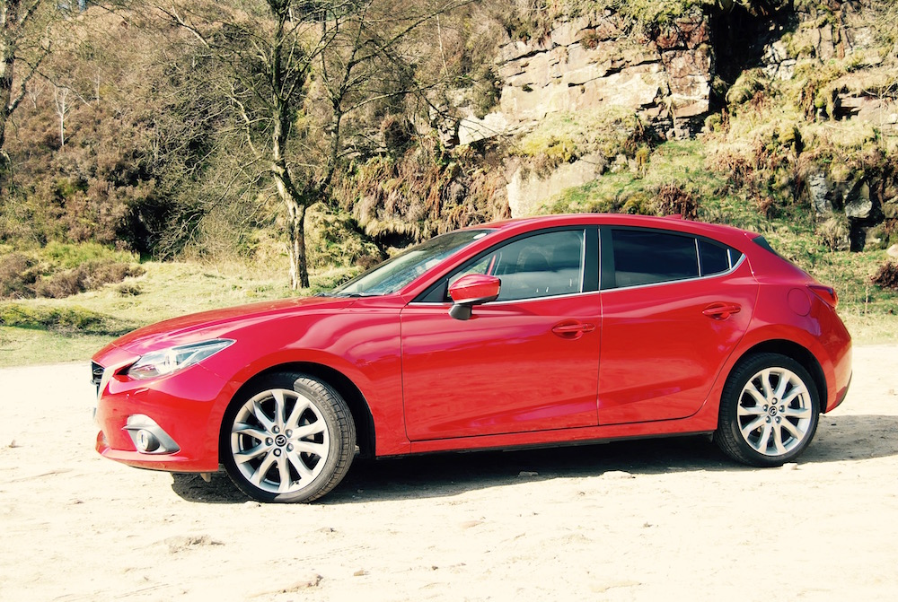 Mazda 3 sport nav red side review