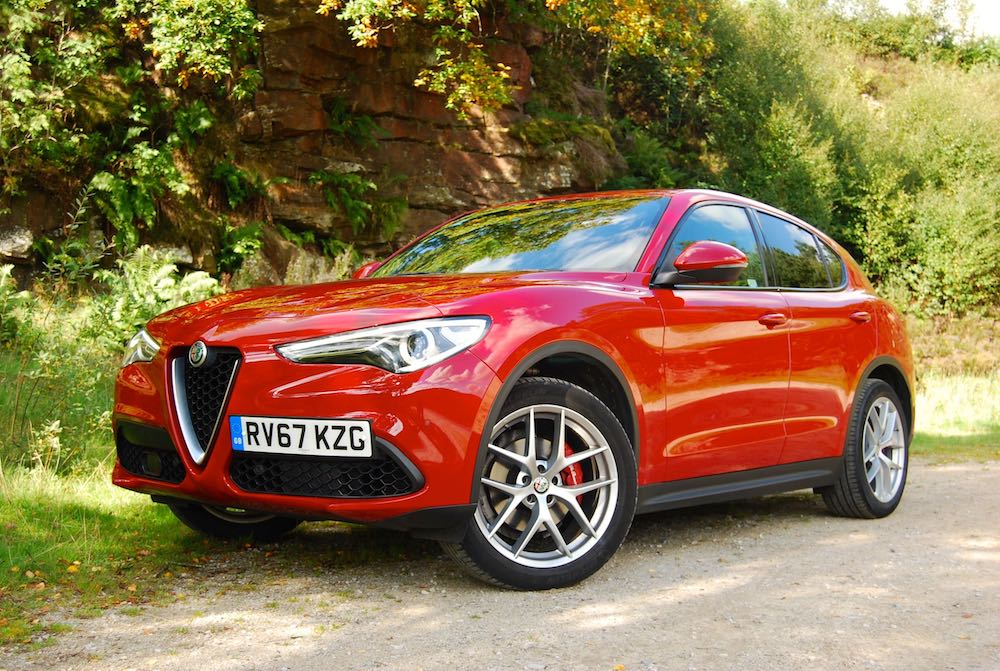 alfa romeo stelvio red front side review roadtest