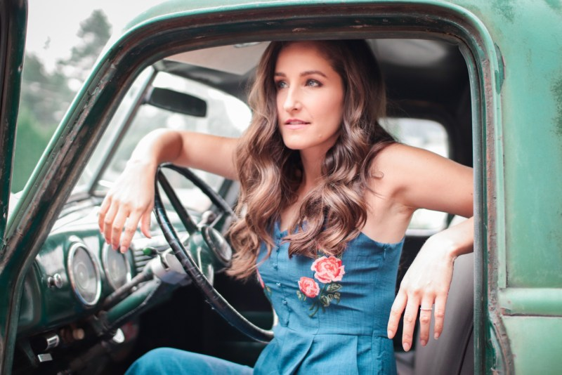 Woman driving truck.