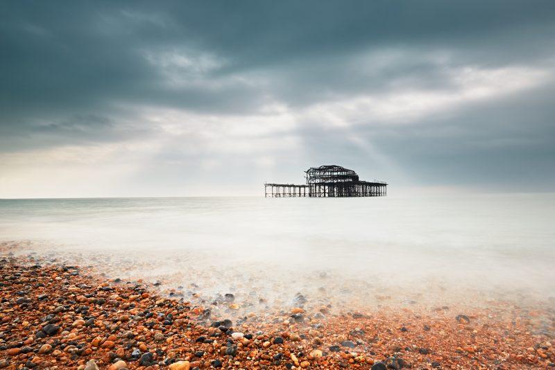 Abandoned pier in ocean.