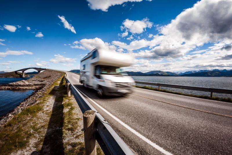 Caravan car RV travels on the highway