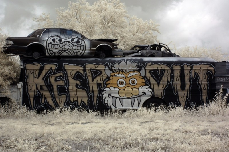 Keep out bus painted in the school bus graveyard