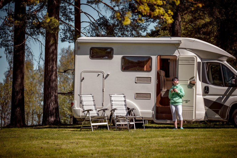 Woman standing in front of camper