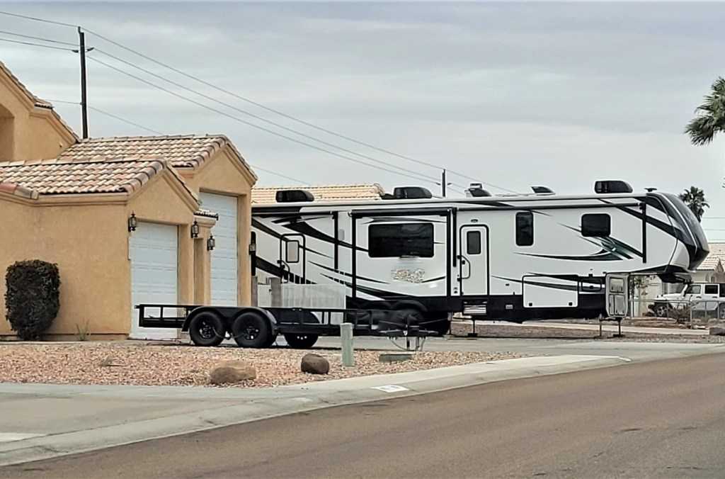 Big RV parked in a small driveway.