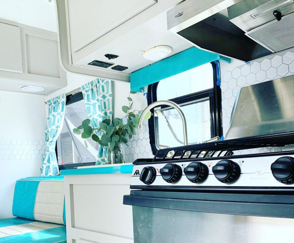 RV kitchen with hexagon backsplash.