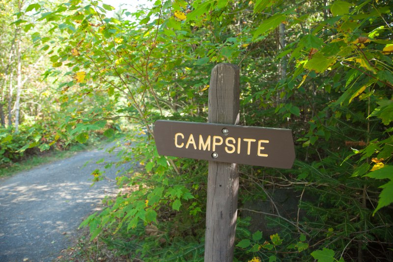 Sign on path to a campsite.