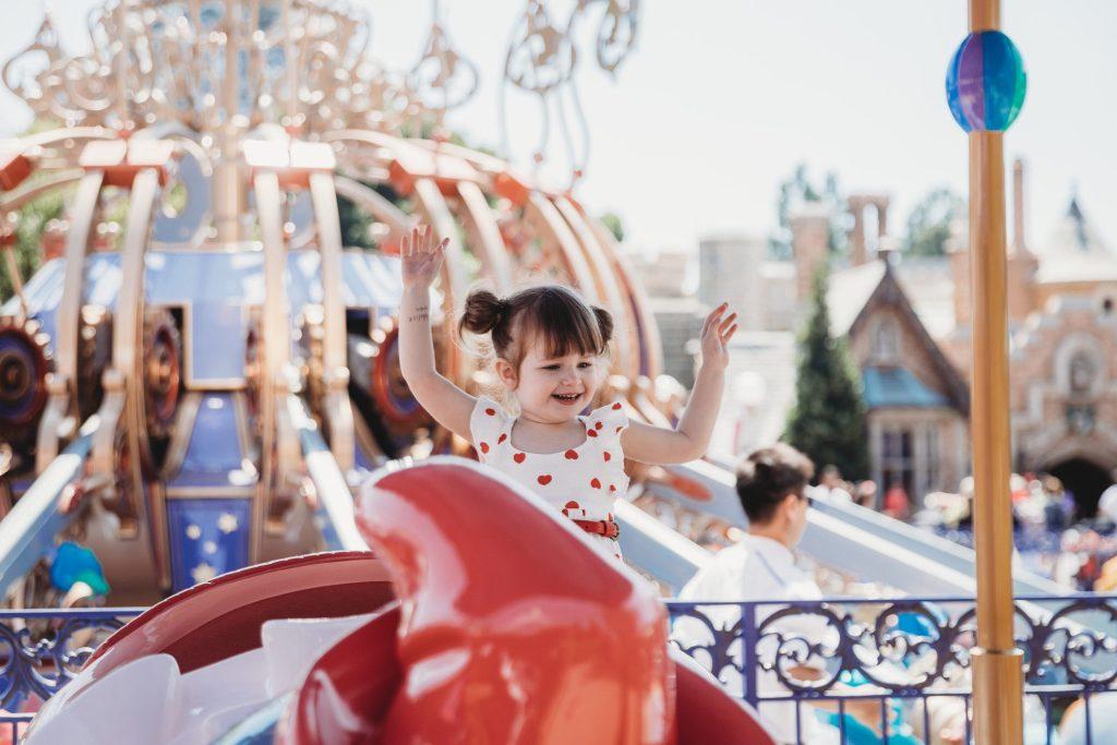 Little girl on ride at Disney World.