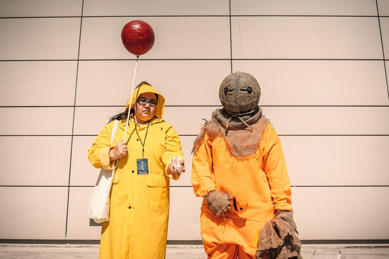 Two people cosplaying in Stephen King costumes.