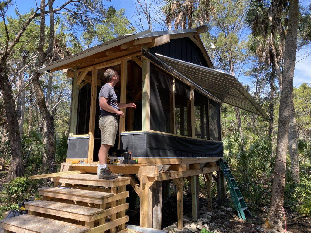 Man building tiny home.