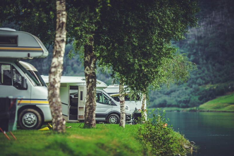 RV Park along water with RVs in them.