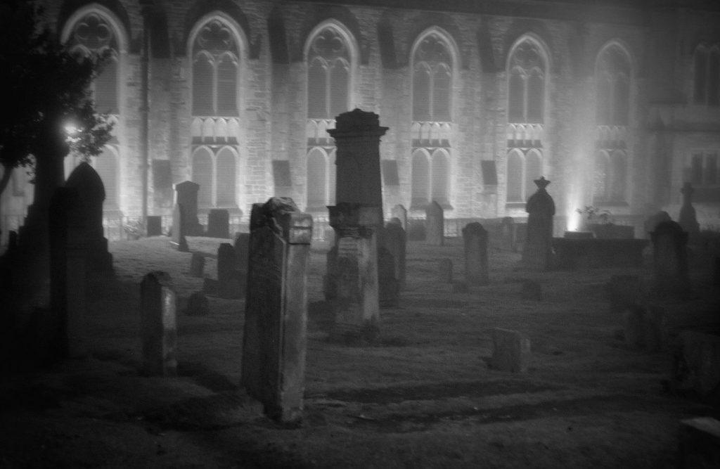 Scary graveyard at night.