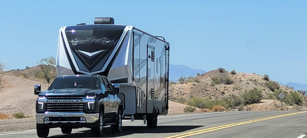 Truck towing fifth wheel RV.