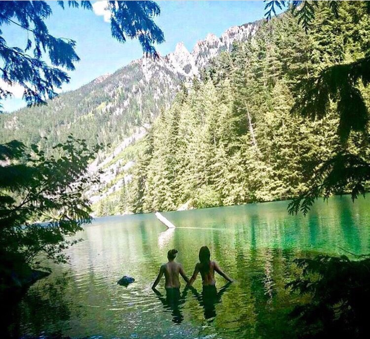 Two friends skinny dipping while camping.