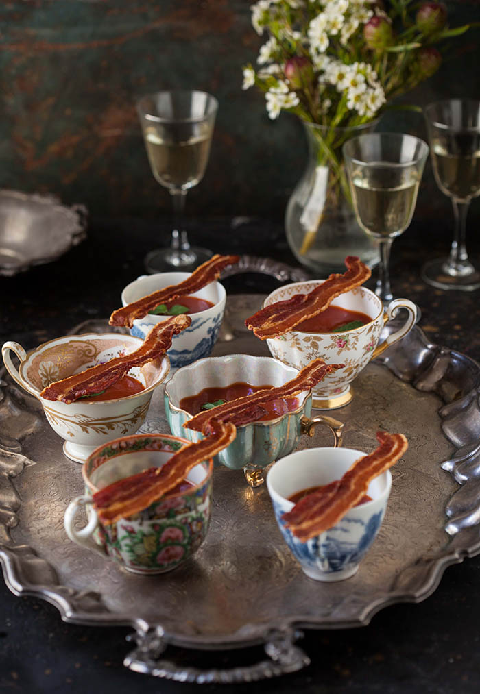 bloody mary shots with crispy bacon strips canapé
