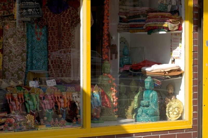 Photograph of storefront with Buddha and Ganesh figurines