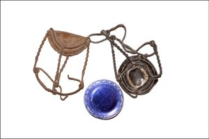 Photograph of metal bottle caps, blue and rusted