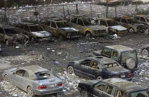 Burned out cars in parking lot near ground zero