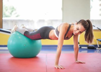 woman using exercise ball