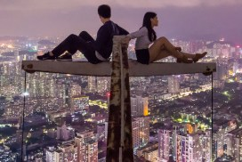 Lonely couple in a place with a great view of the city at night