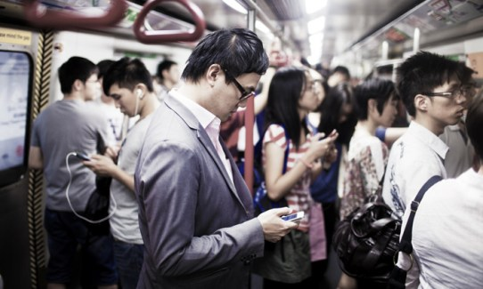 Businessman on the phone in subway train