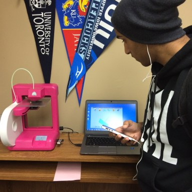 Student loads a file for 3D printing.