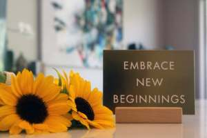 Black-eyed-susans with Embrace New Beginnings sign