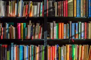 Book shelves full of colorful books that could be used for bibliotherapy