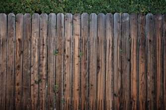 brown wooden fence to illustrate setting boundaries