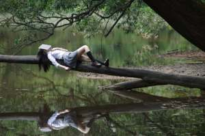 girl on log relaxing