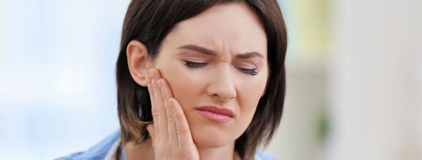 woman holding face toothache.jpg