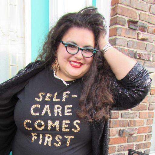 Dr. MC with self care shirt and sequin blazer photo credit Anna Maria Melito 1