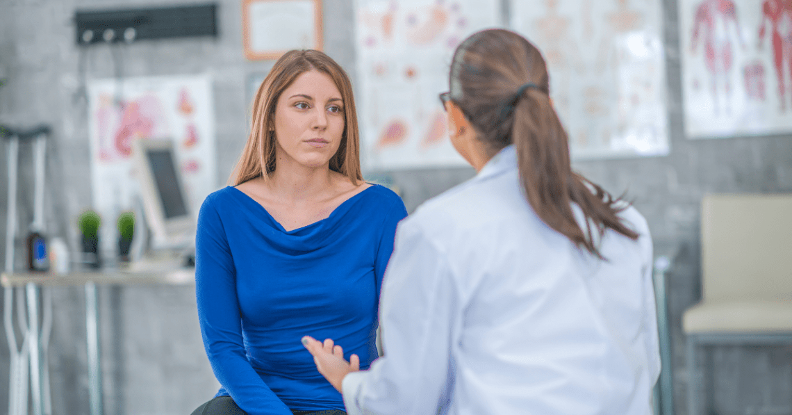 female doctor talking to woman patient