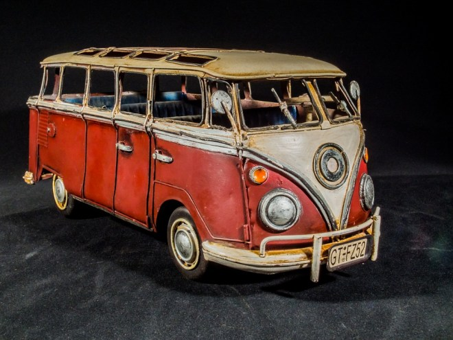 Red and white vintage VW bus model.