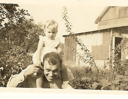 Dad carrying me on his shoulders0001