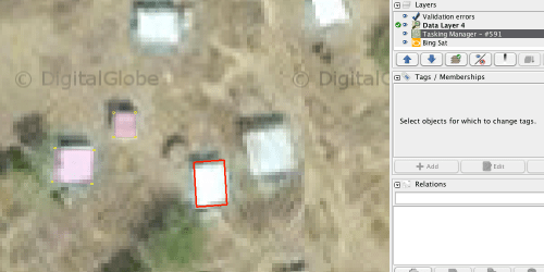 Screenshot of JOSM application, showing buildings (pink boxes on left) and new building being traced (red box, centre)
