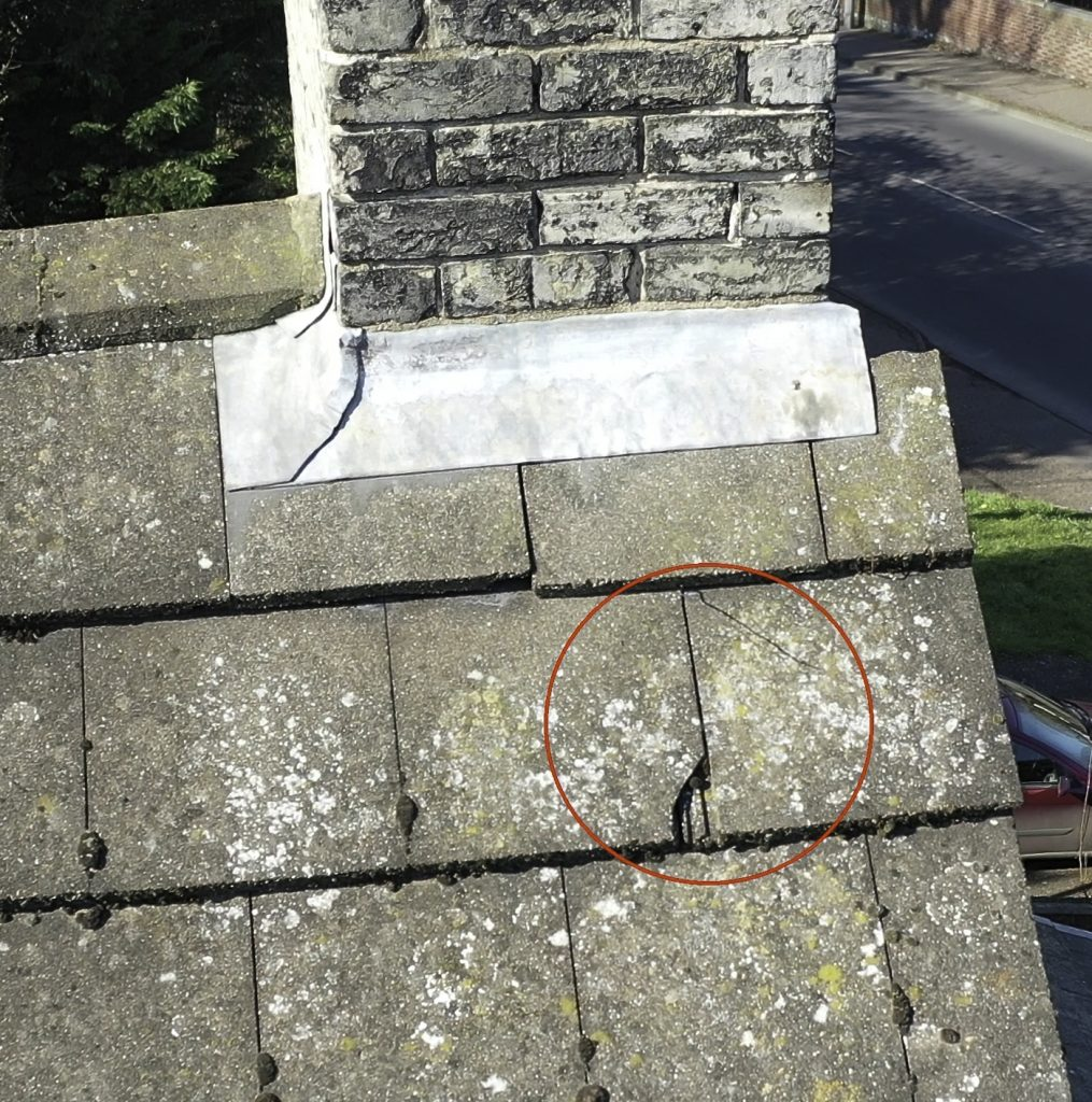 Roof Inspection Case Study Thomas Paine Hotel Cracked tile Close Up
