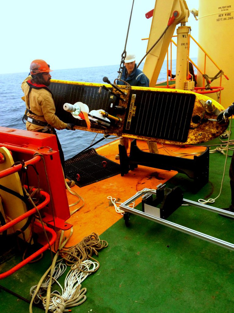 Matt Boyer (left) and Jim Thomson retrieve the Wave Glider in March from off the coast of Argentina.University of Washington
