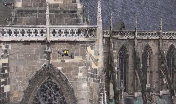 The Intel Falcon 8+ commercial inspection drone inspects a historic sculpture of St. Sixtus inside the Halberstad Cathedral in Saxony-Anhalt, Germany. (Credit: Intel Corporation