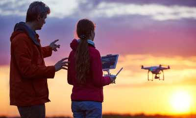 Man and Daughter Flying Drone