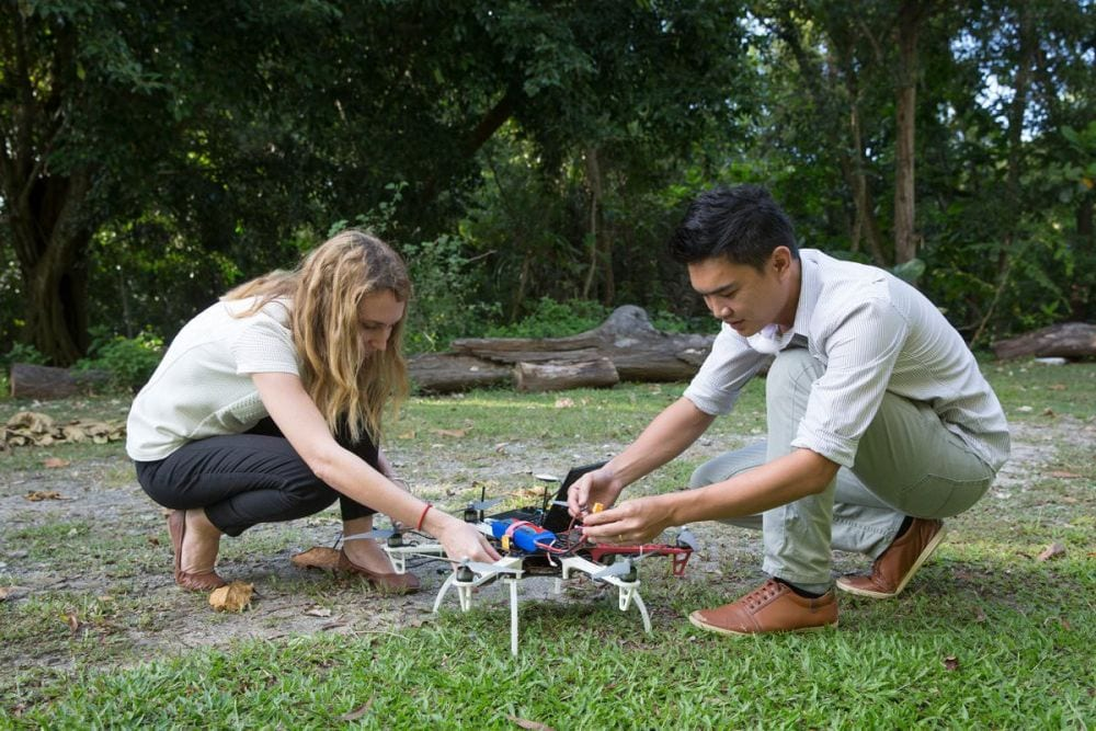 Fornace and colleague prepare drone for monkey malaria project