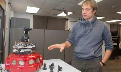 UC professor Dieter Vanderelst demonstrates his bat-inspired robot in a robotics lab. Vanderelst thinks echolocation could be a useful backup system for drone navigation.