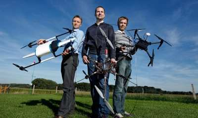 Theys, left, with some self-made drones created with colleagues at the University of Leuven | DIY Drones