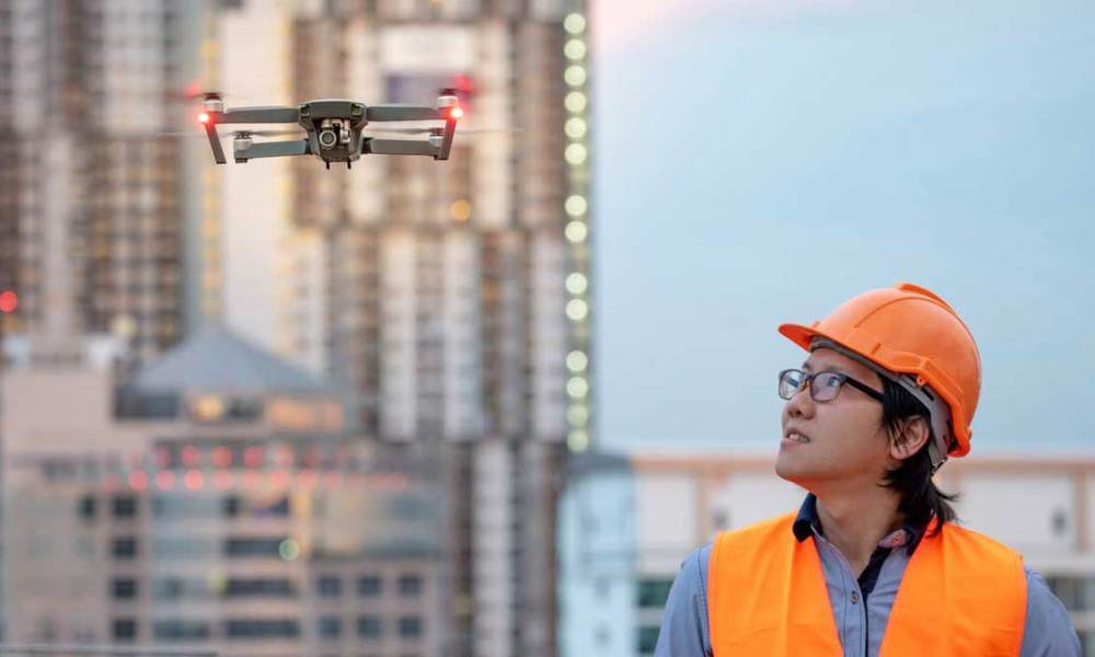 A drone helps a woman at work
